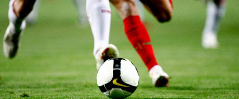 Players Kick Football