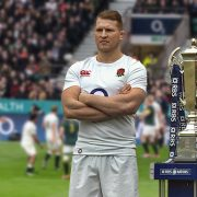Dylan Hartley stands with trophy