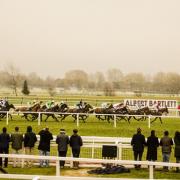 Racegoers at Cheltenham Racecourse