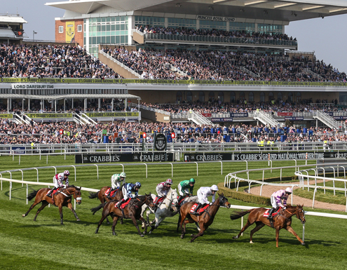 Horses running at Grand National at Aintree Racecourse