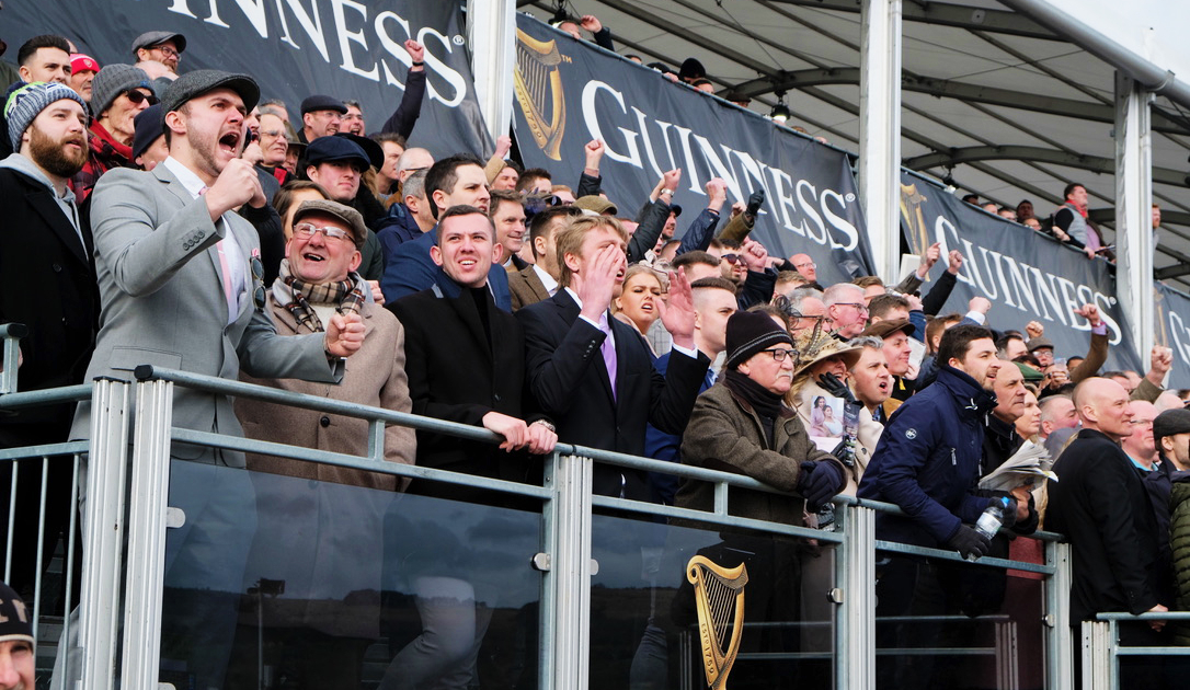 Racegoers in Stands at Cheltenham Festival Cheering